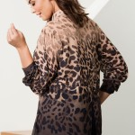 Tie half of your hair up in a ponytail and let the rest flow. Model wearing 149906 Sara The Blouse in Animal Print