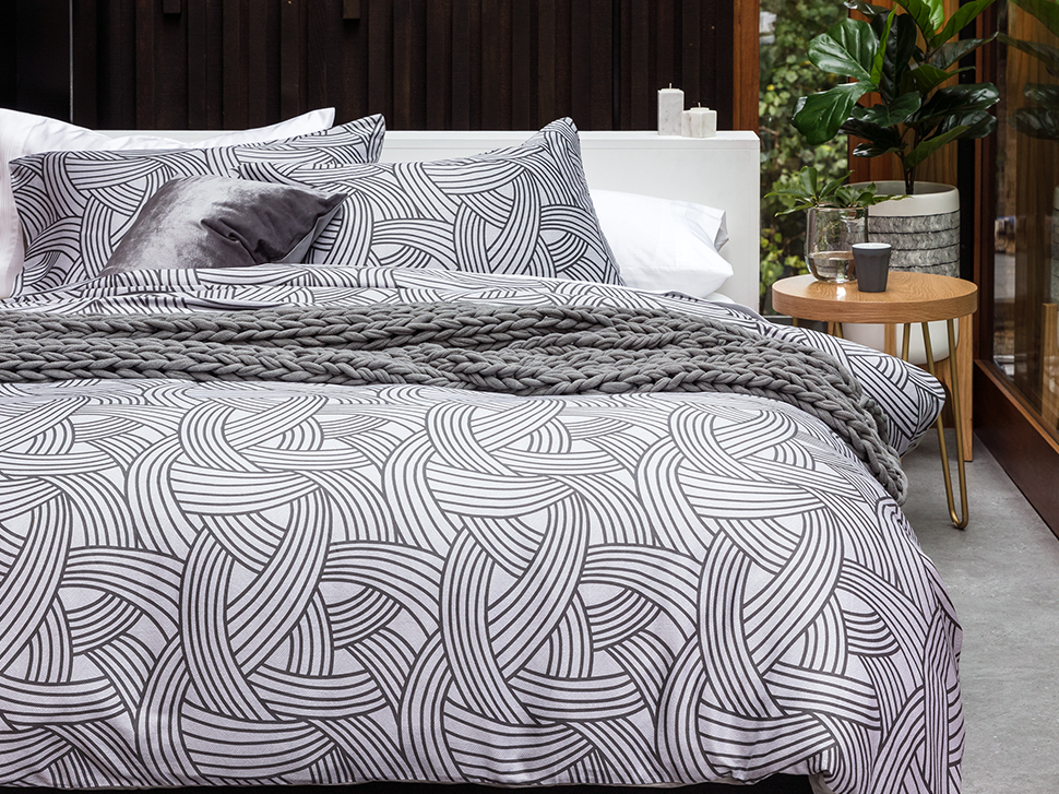 Modern: add some direction to your bedroom with this eternally chic, graphic bedlinen design. Shop: duvet, cushion, side table, floor lamp, planter.