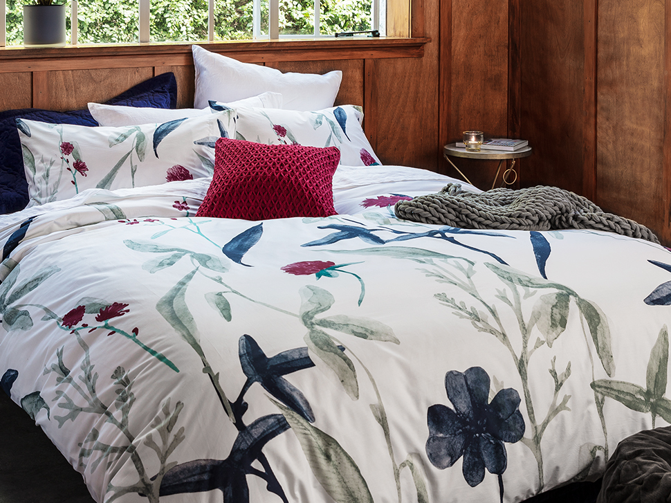 Fresh florals: in an allover floral pattern, this eye-catching watercolour duvet set, feels fresh and modern. Shop: Duvet, side table, cushion.