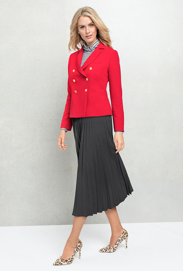 Add a bit of femininity to the strong military jacket with a skirt.