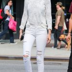 Ripped Jeans with a crop top - The Hadid Family