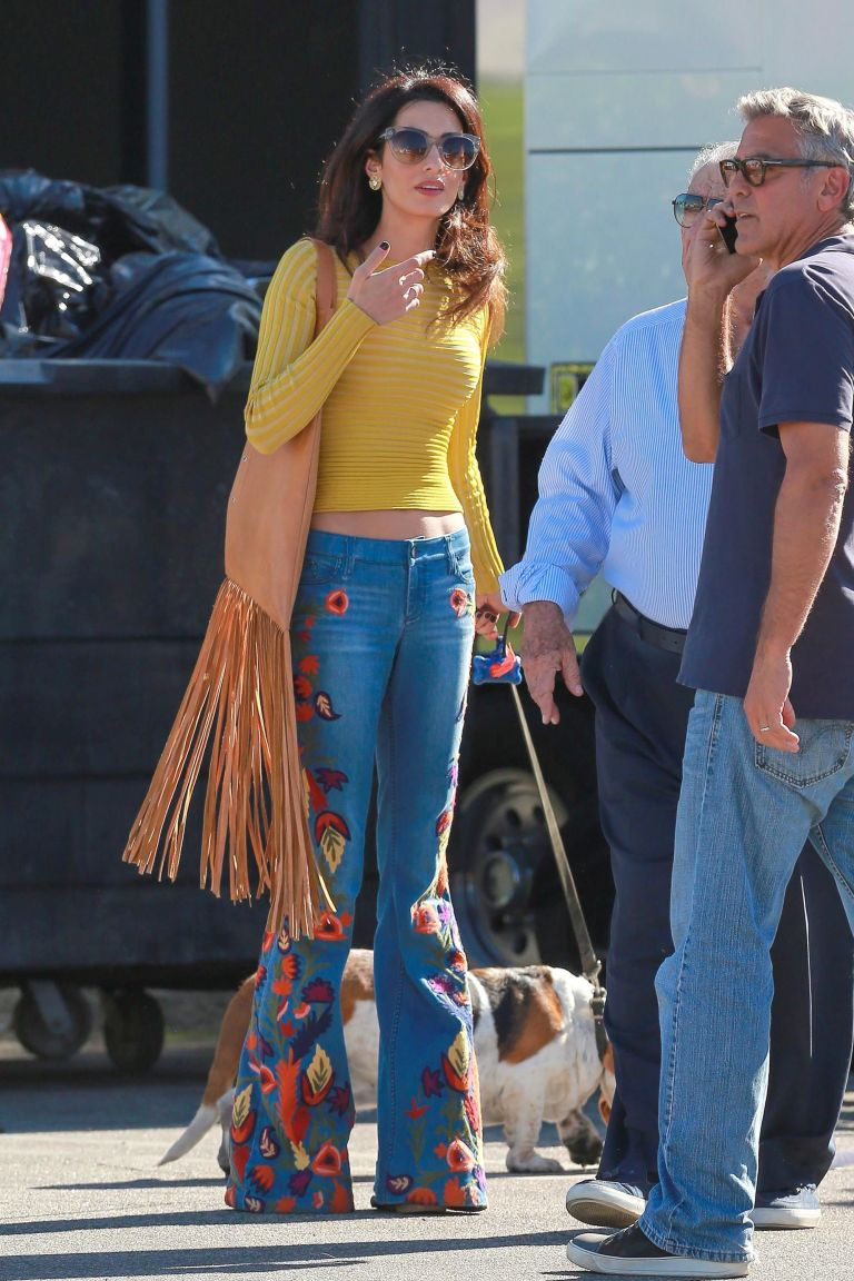Amal Clooney wearing a vintage 70s inspired look - embroidered flowers jeans