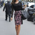 Miranda Kerr pairs her pencil skirt with black handbag and plain black shirt