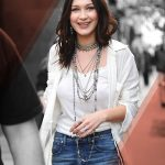 Bella Hadid accessorizing with necklaces and relaxed knit