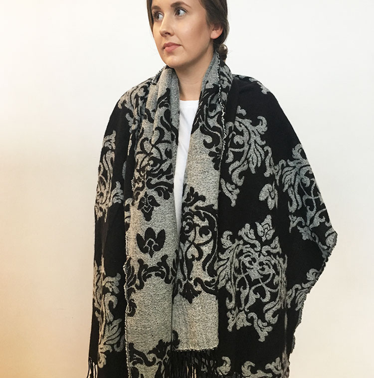 The oversized coat worn as a poncho