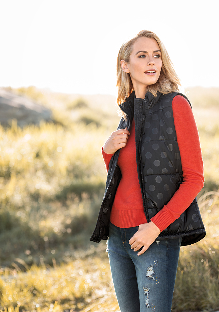 Think comfortable: shop top, puffer vest and jeans.